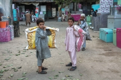 Afghan children who work as  garbage collectors look for recyclable material in Jalalabad. Children who work have very rarely access to education