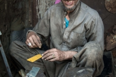 Ironmonger making metalic tools at the ironmonger market in Kabul