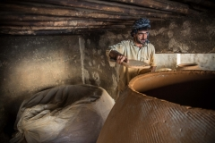 A craftsman builds a tandoori oven from raw clay at a workshop in Kabul