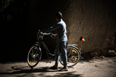 Boy driving his bicycle in Jalalabad