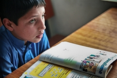 Boy studying french lesson in a school in Jalalabad