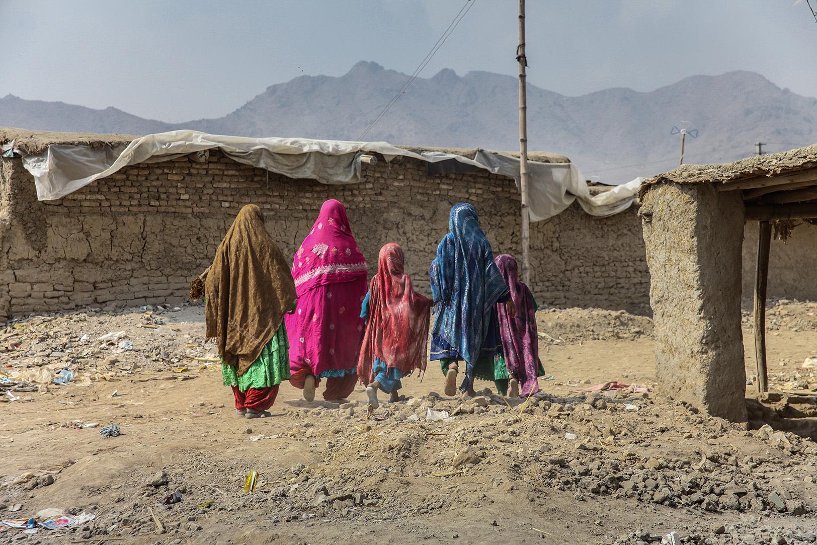 Five sisters walking in a slum in Kabul
