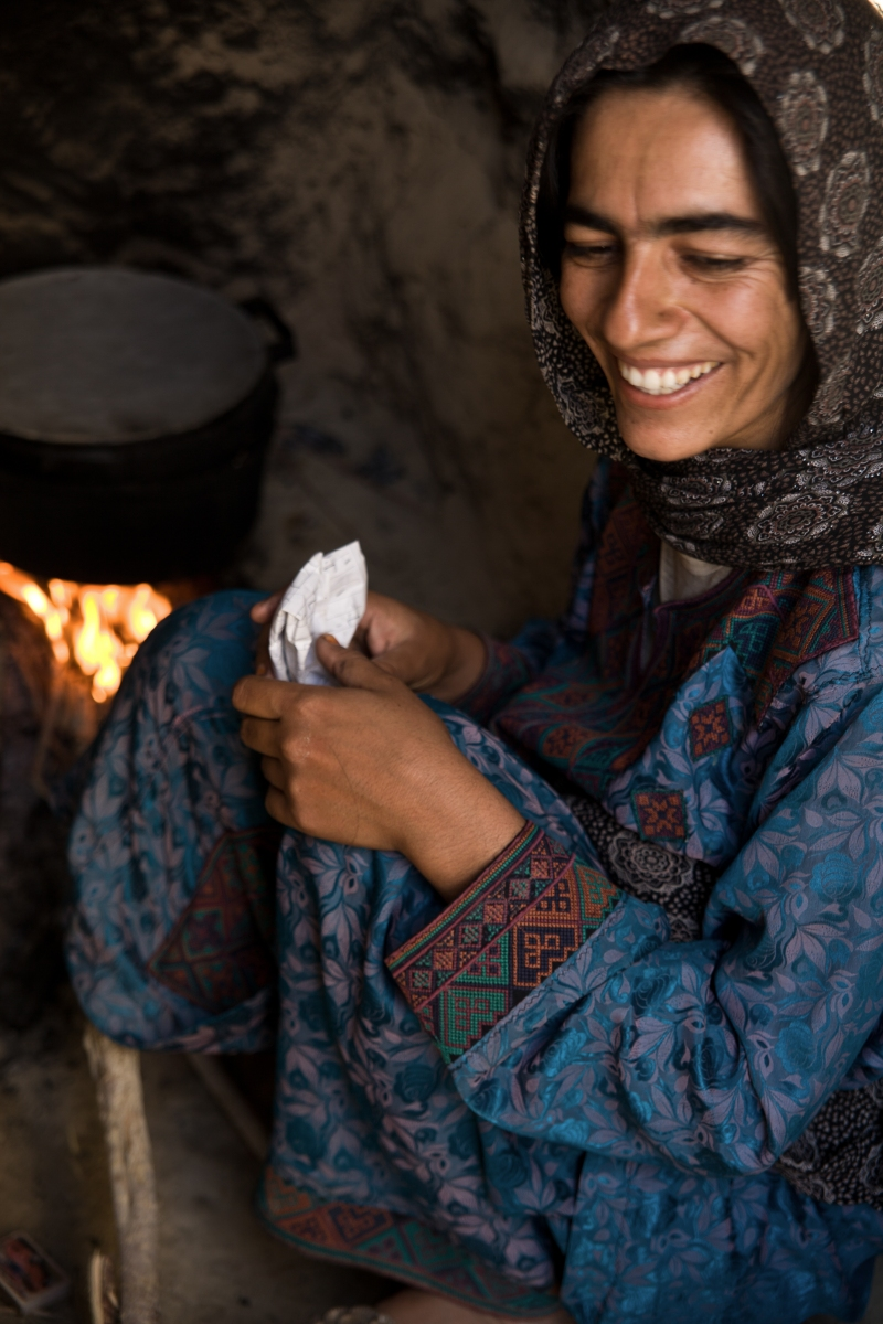 This woman in Nimroz has been given three goats (by Relief International). It has improved her life. She can milk the goat, boils it and feeds her children with the milk