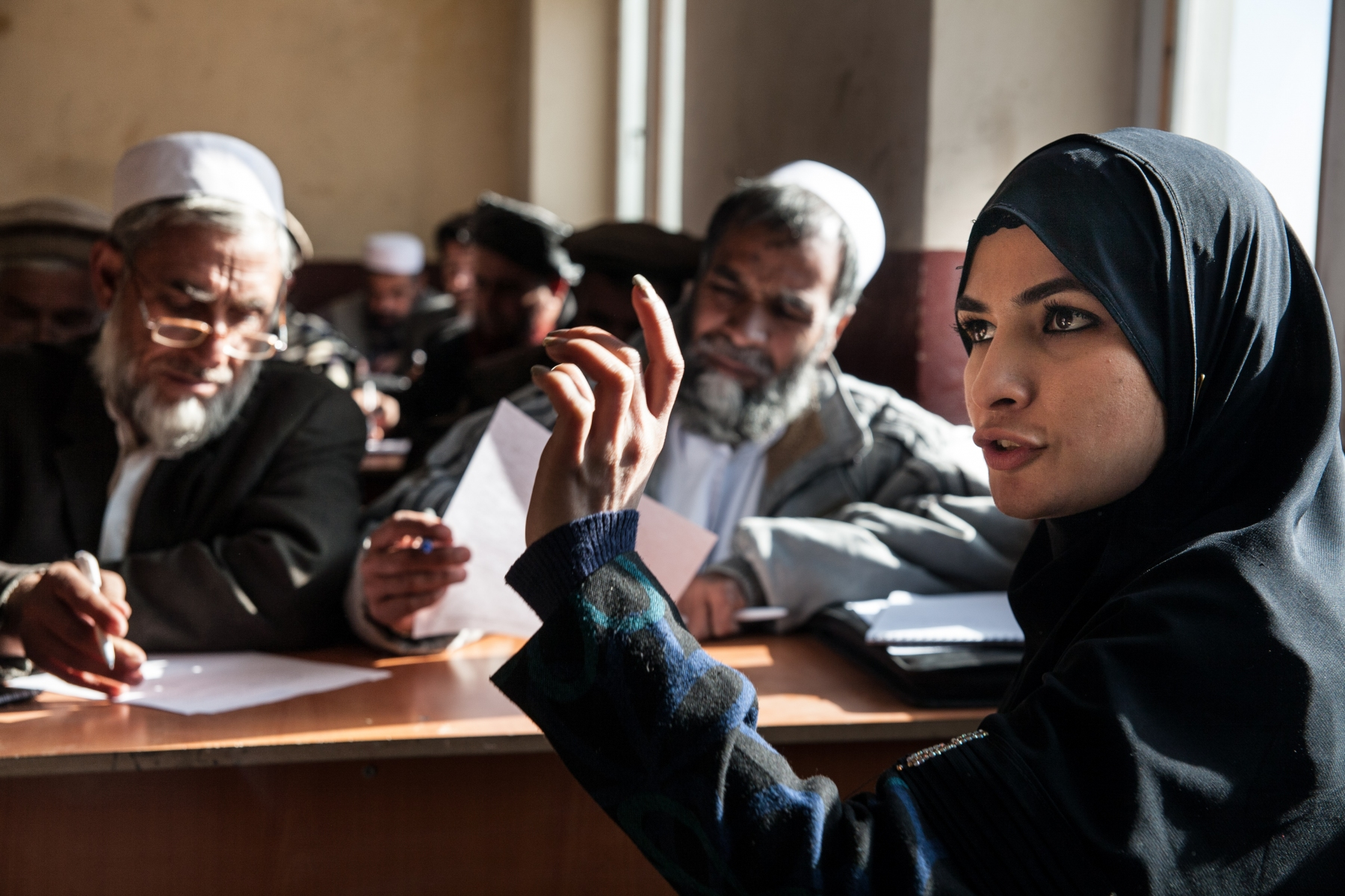 Abida speaking about woman rights during a shura in Paghman