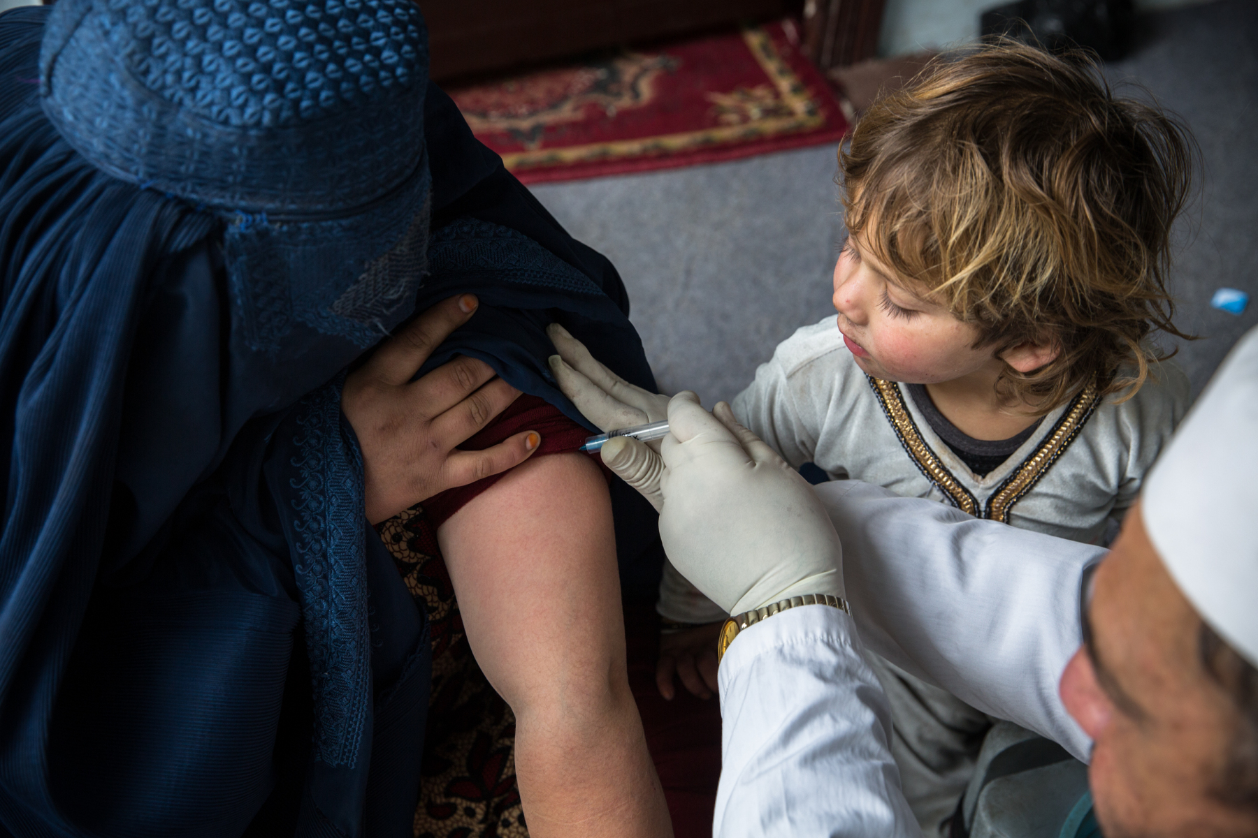A Woman is getting vaccinated with the TB vaccine on a CBOV site. The CBOV project was created to improve access to and increase coverage of immunization services in unserved children and women residing in white areas of the low performing districts and provinces.