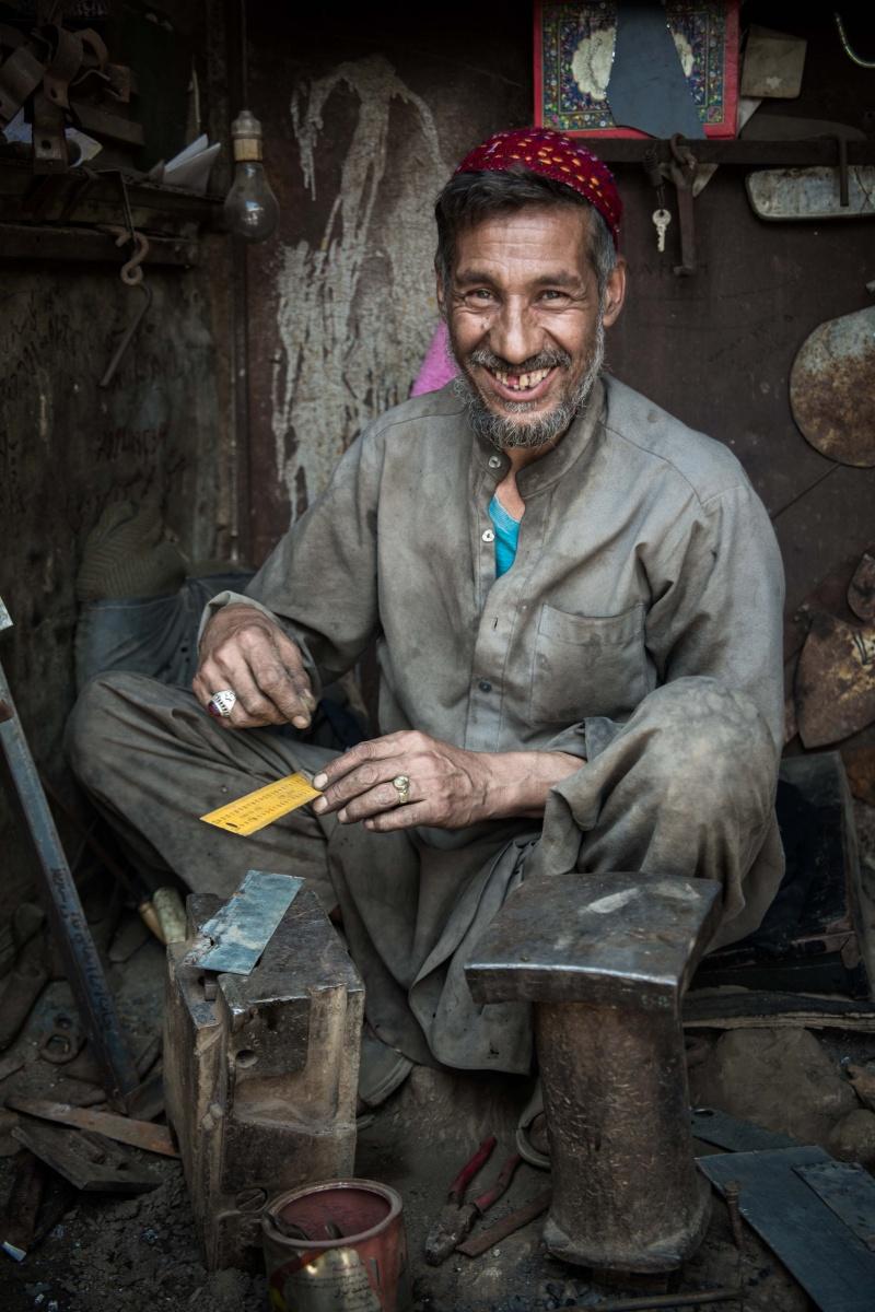Ironmonger making metalic tools at the ironmonger market in Kabul