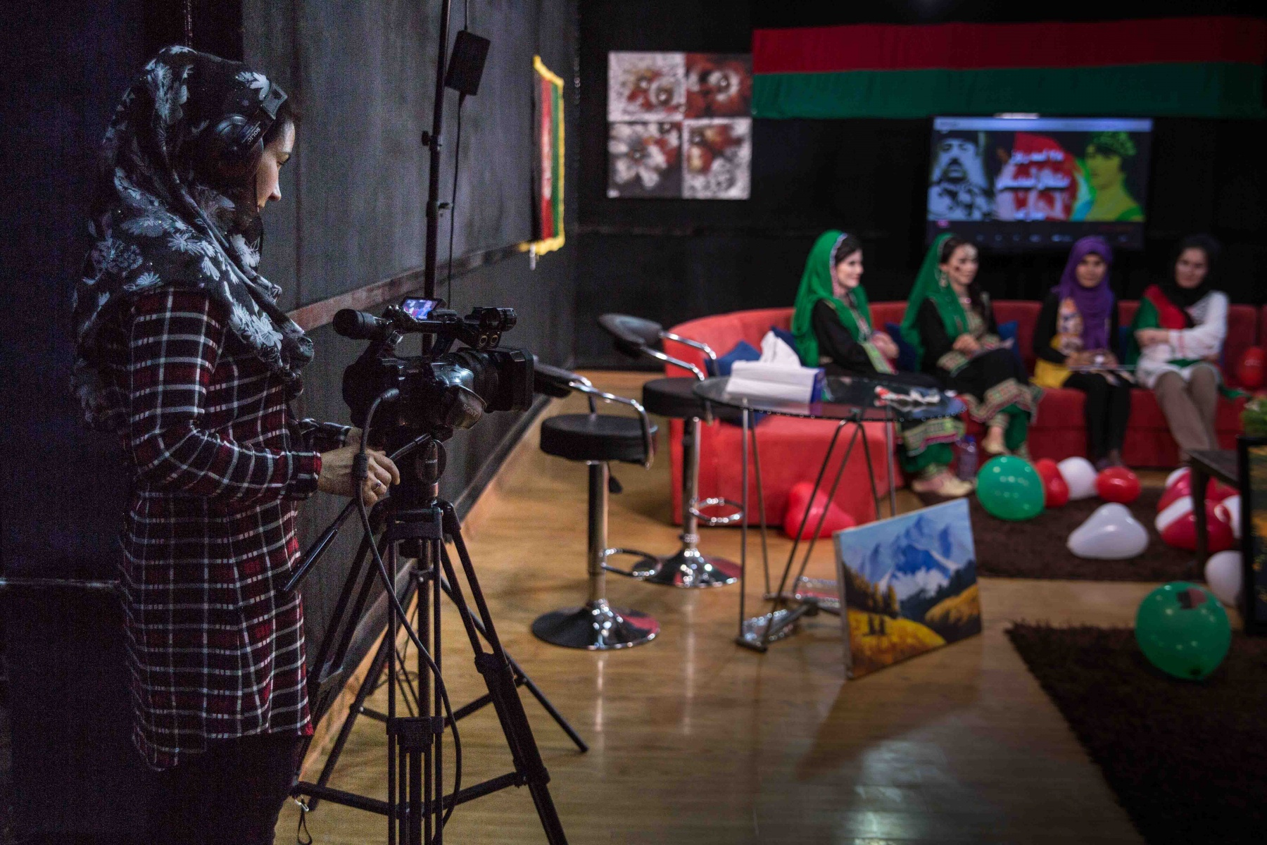 Mari Asifi, the camerawoman films footage for  the morning show Bamshad at Zan TV. The tv channel employs more than 50 women to create its daily program, a mix of news, politics and lifestyle shows