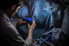 An employee polishes lapis lazuli in a workshop in Kabul